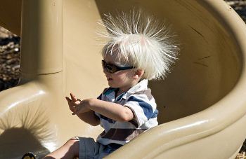 Child On Slide Gaining Charge Of Static Electricity